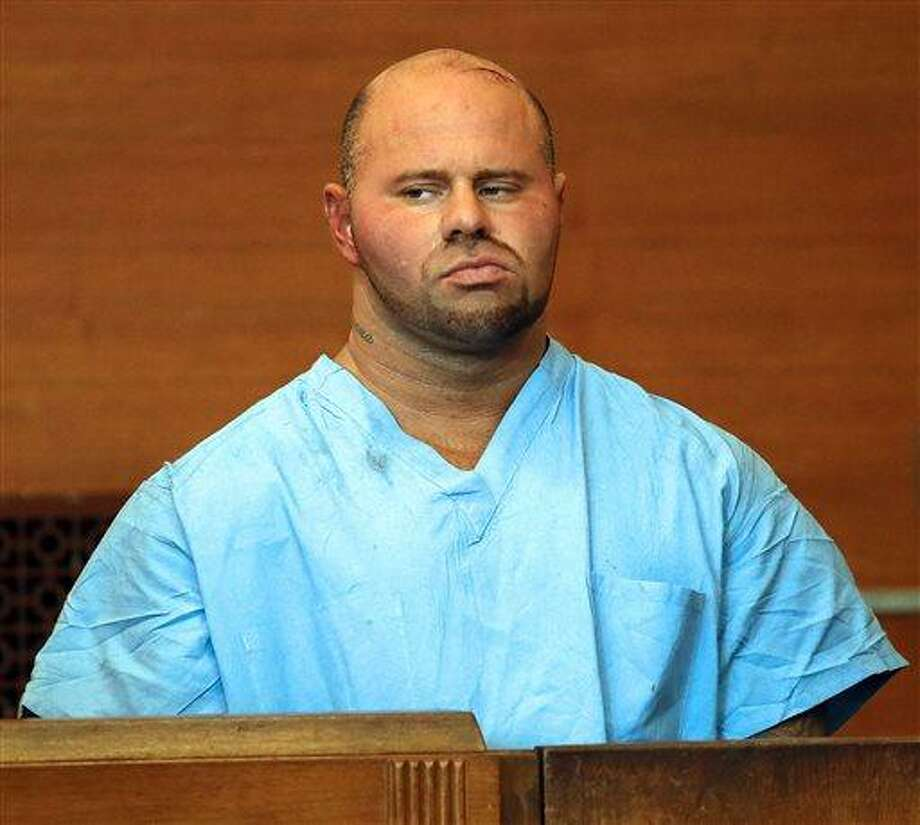 Jared Remy appears at Waltham District Court for his arraignment, Friday, Aug. 16, 2013, in Waltham, Mass., on domestic assault and battery charges in connection with the death of 27-year-old Jennifer Martel. Remy, the son of longtime Boston Red Sox broadcaster Jerry Remy, is being held without bail after pleading not guilty to a charge of murder stemming from allegations that he fatally stabbed his girlfriend at his home. (AP Photo/The Boston Herald, Mark Garfinkel) Photo: AP / Boston Herald