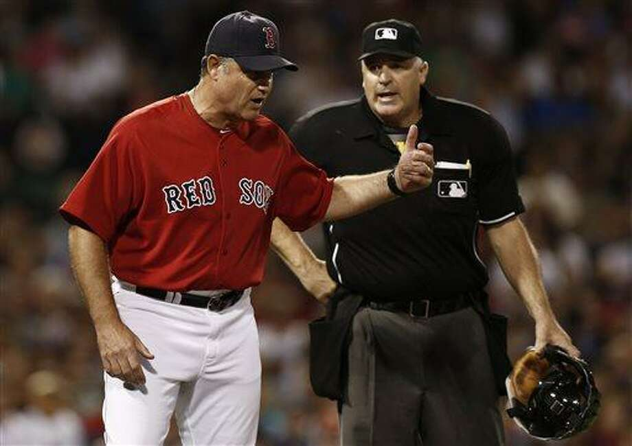 Boston Red Sox manager John Farrell argues with home plate umpire Bill Welke, who ruled that Mike Carp was not hit by a pitch during the seventh inning of a baseball game against the New York Yankees at Fenway Park in Boston Friday, Aug. 16, 2013. (AP Photo/Winslow Townson) Photo: AP / FR170221 AP