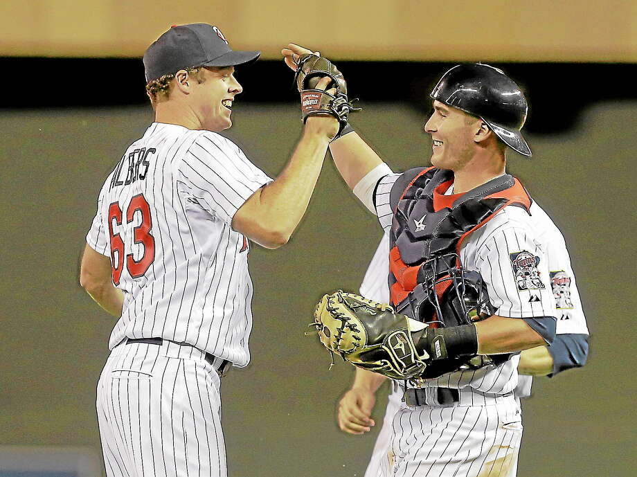 Minnesota Twins catcher Chris Herrmann, right, congratulates Minnesota Twins pitcher Andrew Albers after he sut out the Cleveland Indians 3-0 in a baseball game, Monday, Aug. 12, 2013 in Minneapolis. Albers gave up only two hits to the Indians as he picked up his second win. Photo: Jim Mone—The Associated Press  / AP