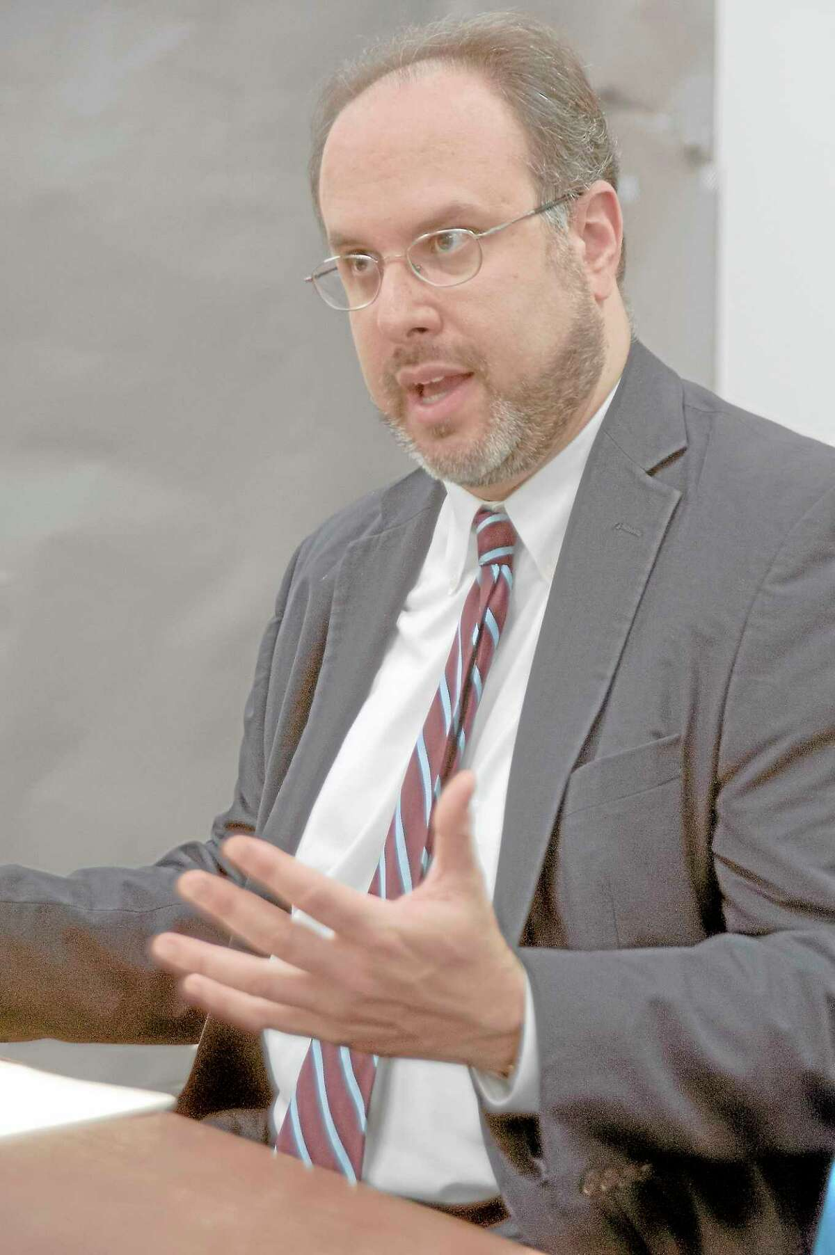 State Education Commissioner Stefan Pryor talks at an editorial bord meeting at the New Haven Register in 2013.
