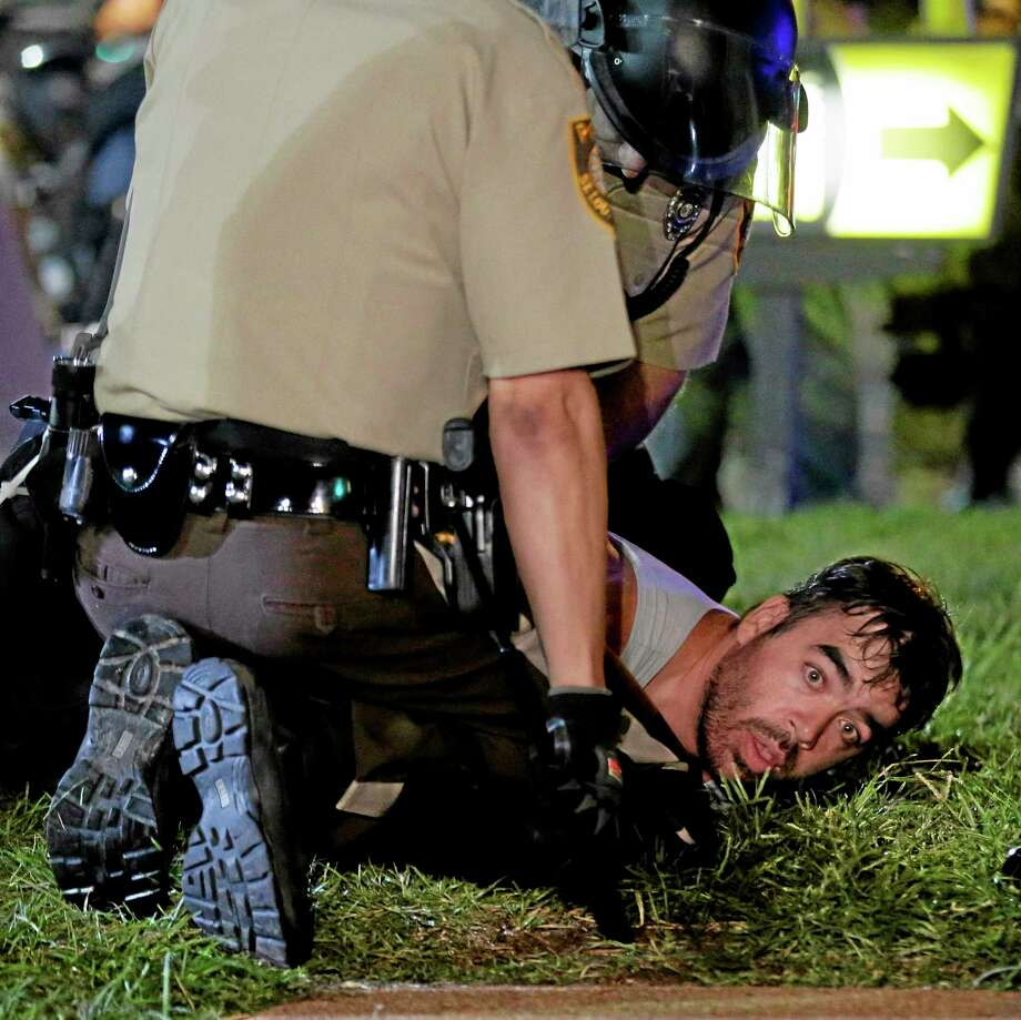 A man is detained by police during a protest Monday for Michael Brown, who was killed by a police officer Aug. 9 in Ferguson, Missouri. Photo: THE ASSOCIATED PRESS  / AP