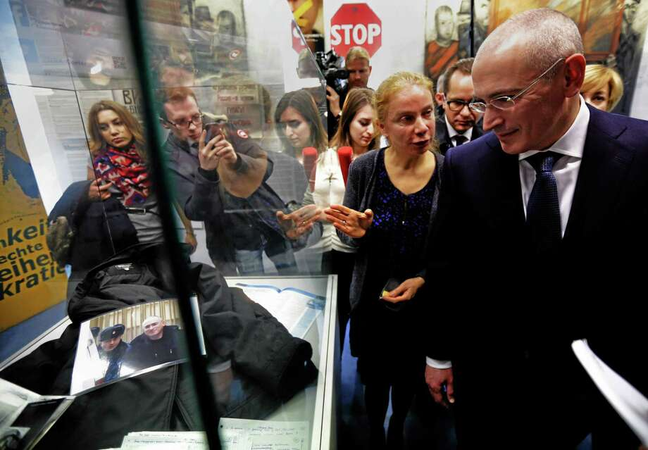 Mikhail Khodorkovsky, right  walks through Checkpoint Charlie Museum accompanied by museum director, Alexandra Hildebrandt, front left, as he arrives for a press conference at the museum in Berlin, Sunday Dec. 22, 2013.  The former oil baron Mikhail Khodorkovsky was reunited with his family in Berlin on Saturday, a day after being released from a decade-long imprisonment in Russia. AP Photo/dpa,Michael Kappeler Photo: AP / dpa