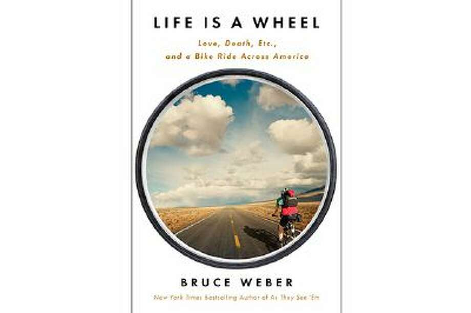 "This book cover image released by Scribner shows ""Life is a Wheel: Love, Death, Etc., and a Bike Ride Across America,"" by Bruce Weber. (AP Photo/Scribner) Photo: AP / Scribner"