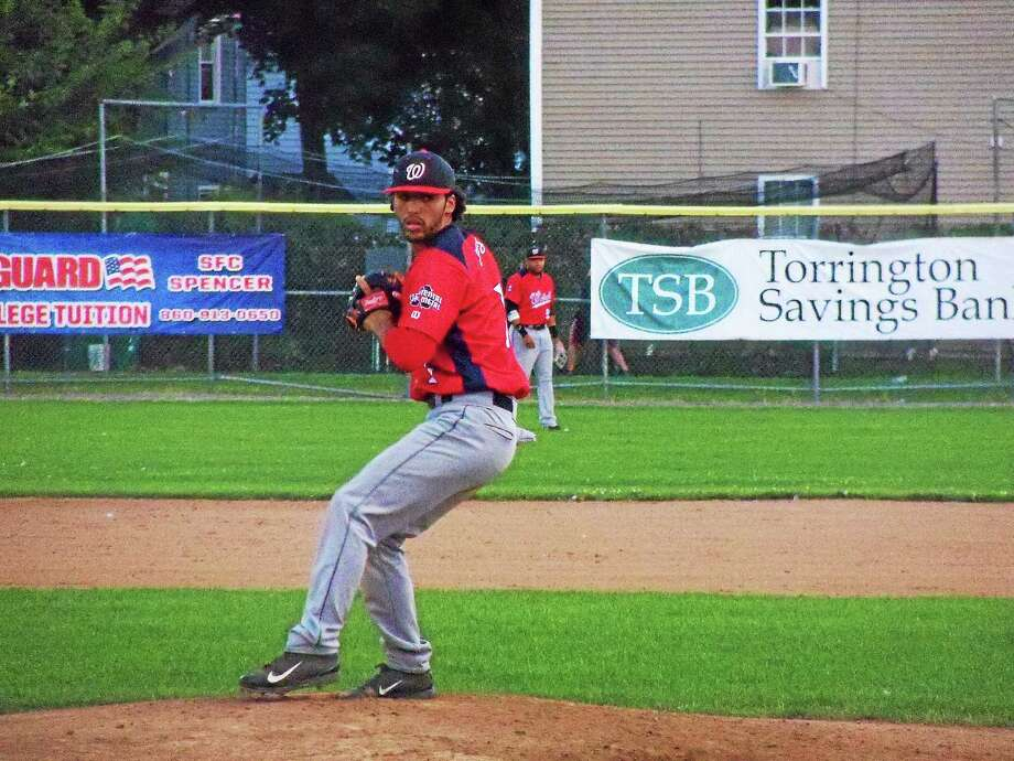 Wolcott's Manny Cruz throws against the Terryville Black Sox. Cruz pitched a shutout allowing just five hits with eight strikeouts and four walks. Photo: Peter Wallace — Register Citizen
