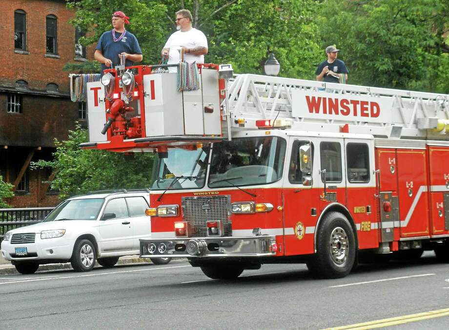 A Winsted fire truck drives in the annual Winsted Fireman's Parade Saturday. Photo: Stephen Underwood — Special To The Register Citizen