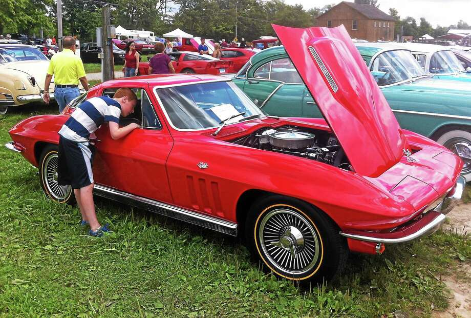 A young man peers into a classic Corvette on display at the 39th annual Litchfield Hills Historical Automobile Club auto show at the Goshen Fairgrounds Sunday. Photo: John Nestor — Special To The Register Citizen
