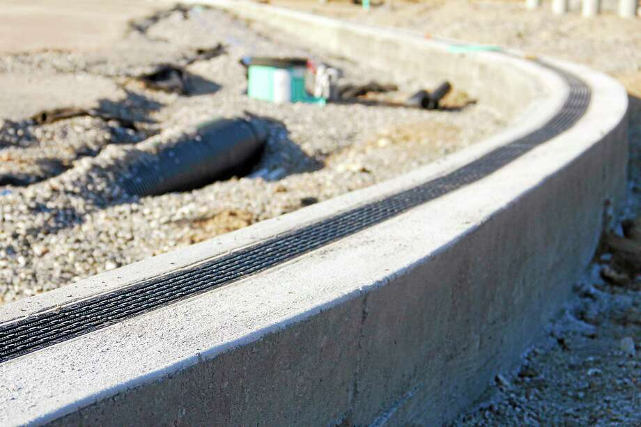 A portion of the concrete trench drains at the Torrington High School athletic fields on Monday in Torrington. The trench drains are among the first pieces of the $2.7 million athletic field renovation project to be completed. Photo: Esteban L. Hernandez — The Register Citizen