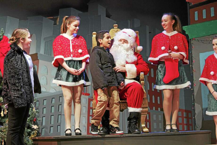 """Photos by Marianne Killackey """"Miracle on 34th Street"""" cast members include Santa (Andrew Schimanski) Michael (Joel Santos), mom (Rebekah Smith)  and elves Left to right Gianna Delmonte, Nicolette Marinello and Julianna Provenzano. The show is being performed this weekend at Torrington High School. Photo: Journal Register Co. / 2014"""