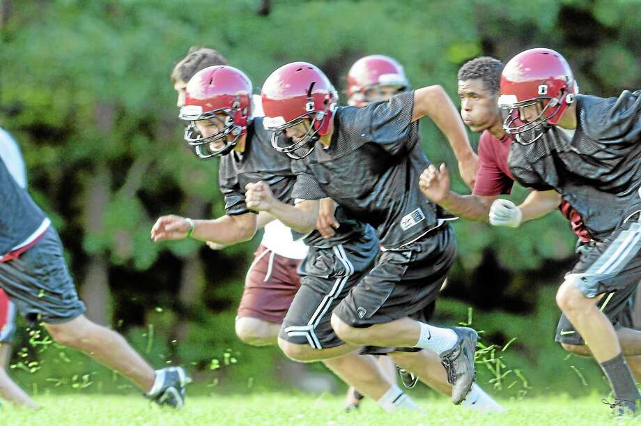 Torrington football players, sprint during drills during their first practice of the season. Photo: Laurie Gaboardi—Register Citizen