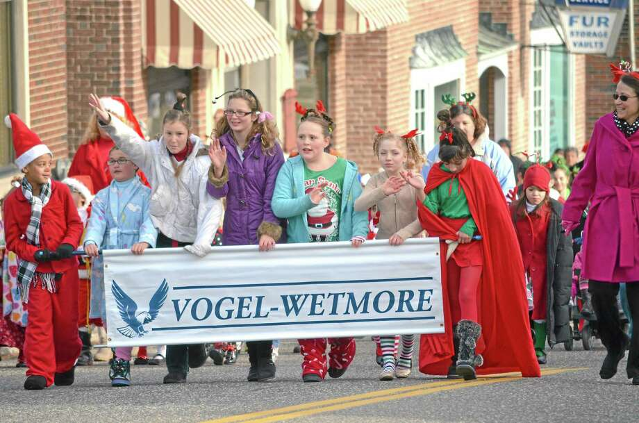 John Berry/Register Citizen ¬ Students from Vogel-Wetmore march in the parade celebrating Christmas Village in Torrington on Sunday to kick off the holiday attraction's 65th year. Photo: Journal Register Co.