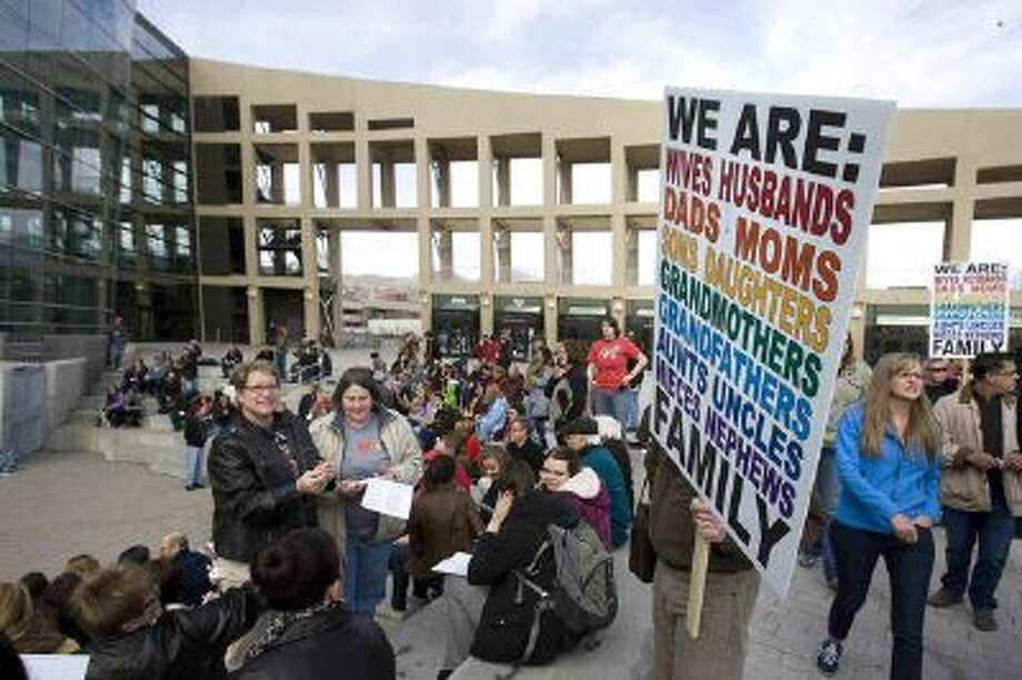 People hold a vigil in support of same-sex marriage at a Salt Lake City amphitheater on March 25, 2013.