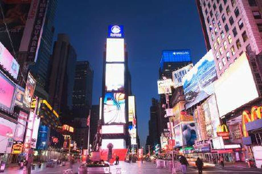 Times Square, a famous tourist destination in New York City, came in at No. 12 in the top 20 places people check in at on Facebook. (Getty Images) Photo: Getty Images / (c) Cultura Travel/Alan Schein