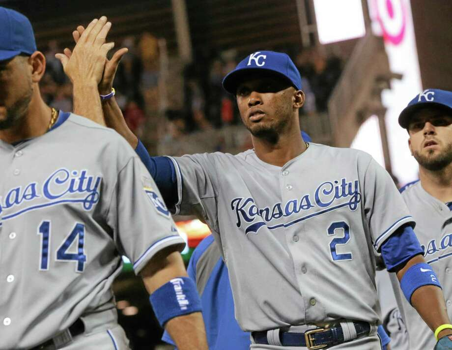Kansas City shortstop Alcides Escobar (2) goes through the celebration line after the Royals defeated the Minnesota Twins 6-5 on Friday in Minneapolis. Photo: Jim Mone — The Associated Press  / AP