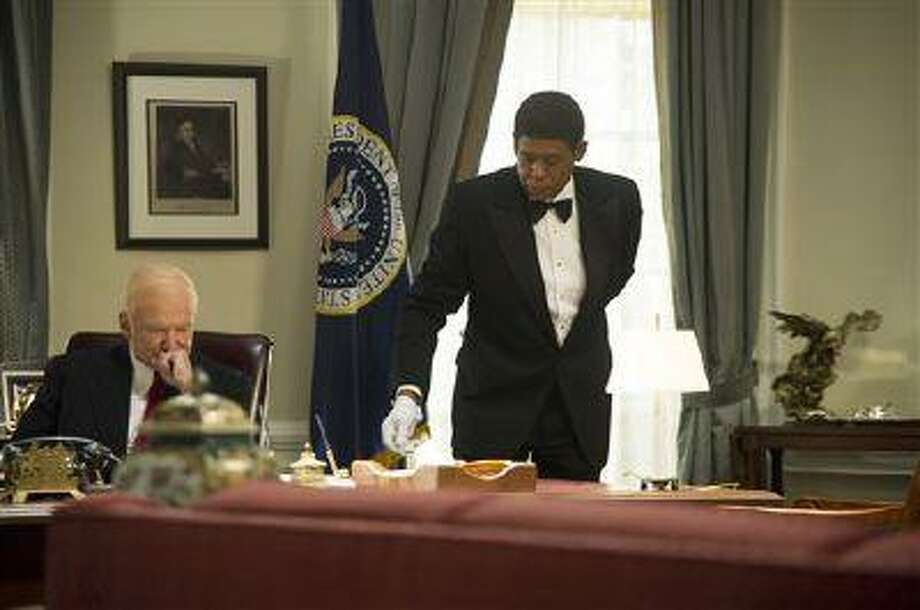 """This film image released by The Weinstein Company shows Robin Williams as Dwight Eisenhower, left, and Forest Whitaker as Cecil Gaines in a scene from """"Lee Daniels' The Butler."""" (AP Photo/The Weinstein Company, Anne Marie Fox) Photo: AP / The Weinstein Company"""
