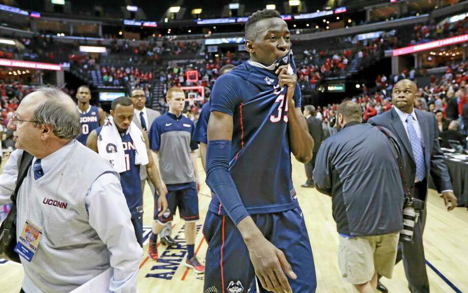 UConn center Amida Brimah (35) leaves the court following the Huskies' 71-61 loss to Louisville in the American Athletic Conference tournament championship game on Saturday in Memphis, Tenn. Photo: Mark Humphrey — The Associated Press  / AP