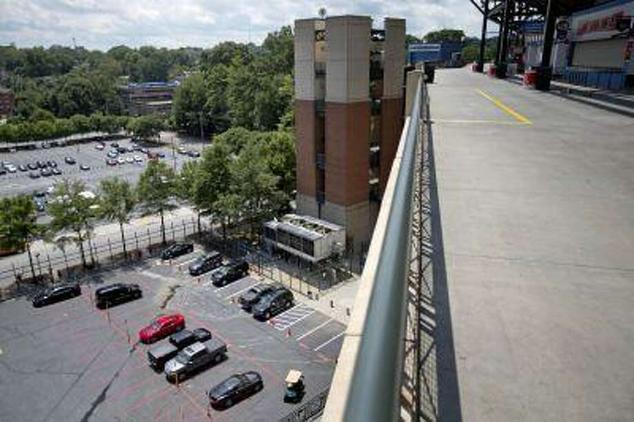The player's parking lot is seen from the upper-level platform from where 30-year-old Ronald Homer fell during Monday night's game at Turner Field, Tuesday, Aug. 13, 2013, in Atlanta. It was at least the third time a sports fan has fallen from a stadium in Atlanta in the past year. Homer fell more than 60 feet (18 meters) from the upper levels of Turner Field onto a parking lot on Monday night. At least four witnesses told police that no one else was standing near him when he fell over a fourth-level railing into a parking lot for players. Homer's death appeared to be an accident, authorities said. Photo: ASSOCIATED PRESS / AP2013