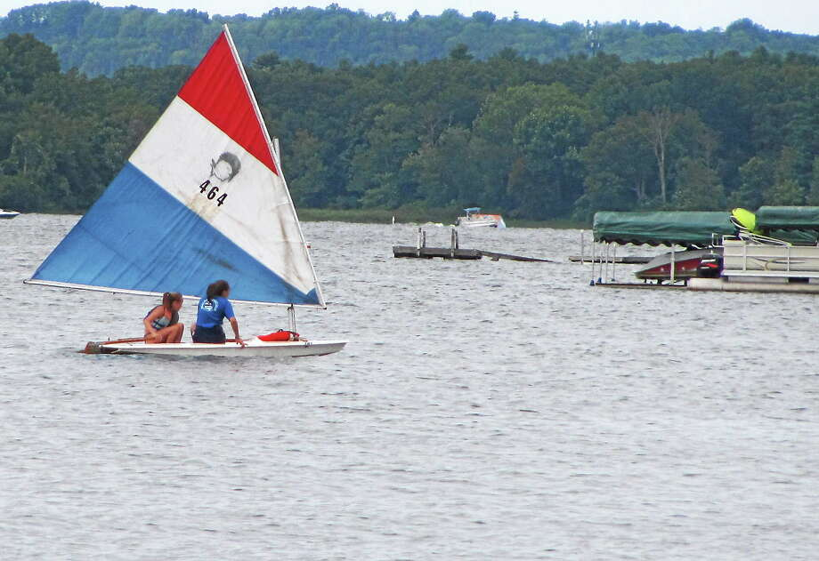 John Nestor - Special to The Register Citizen Sailors take a small boat out on Bantam Lake Saturday during the inaugural Bantam Lake Day celebration in Morris. Photo: Journal Register Co.