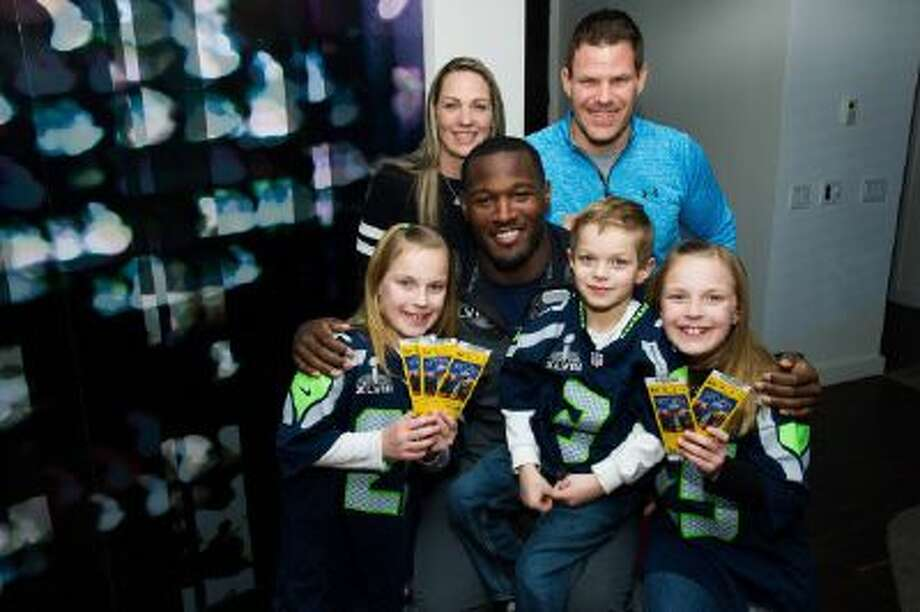 On behalf of Duracell, Derrick Coleman of the Seattle Seahawks presented surprise tickets to Super Bowl XLVII to the Kovalcik family; from left, Erin Kovalcik, Tracy Kovalcik, Derrick Coleman, Aiden Kovalcik, Jake Kovalcik and Riley Kovalcik, on Tuesday, Jan. 28, 2014 in Hoboken, N.J.