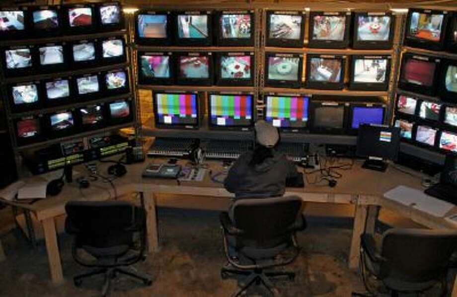 """Jenny Green, sound supervisor for MTV's """"The Real World,"""" checks microphone levels from the control room."""