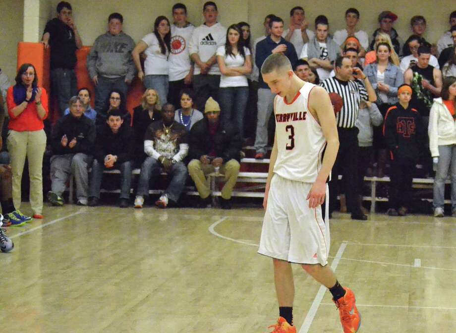 Terryville senior Tyler Trillo walks off his home court for the final time as the Kangaroos are eliminated from the Class S State Tournament, 72-41 against Bloomfield. Photo: Pete Paguaga — Register Citizen