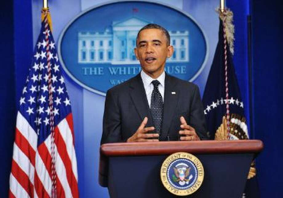 President Barack Obama will give a year-end press conference Friday. Photo: AFP/Getty Images / 2013 AFP