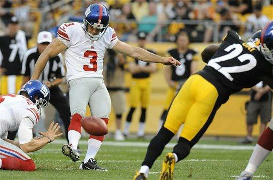 New York Giants' Josh Brown (3) kicks a field goal as Pittsburgh Steelers' William Gay (22) rushes during the first quarter of an NFL preseason football game Saturday, Aug. 10, 2013, in Pittsburgh. (AP Photo/Don Wright) Photo: AP / FR87040 AP