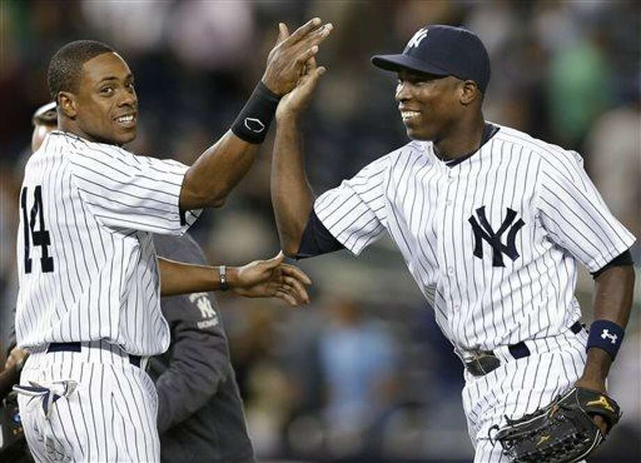 New York Yankees right fielder Curtis Granderson, left, congratulates left fielder Alfonso Soriano after the Yankees' 11-3 victory over the Los Angeles Angels in a baseball game Wednesday, Aug. 14, 2013, in New York. (AP Photo/Kathy Willens) Photo: AP / AP
