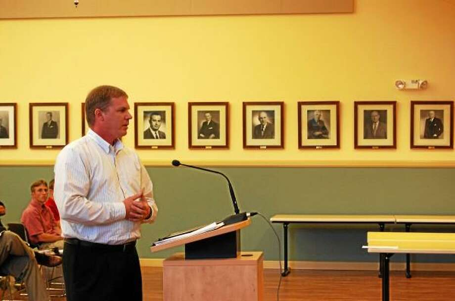 Cory Fellows speaks to the Planning and Zoning Commission during their meeting on Wednesday, Aug. 14. Fellows was speaking on behalf of the Torringford West Apartments, which is looking to expand with an 800-square-foot addition. (Esteban L. Hernandez-Register Citizen)