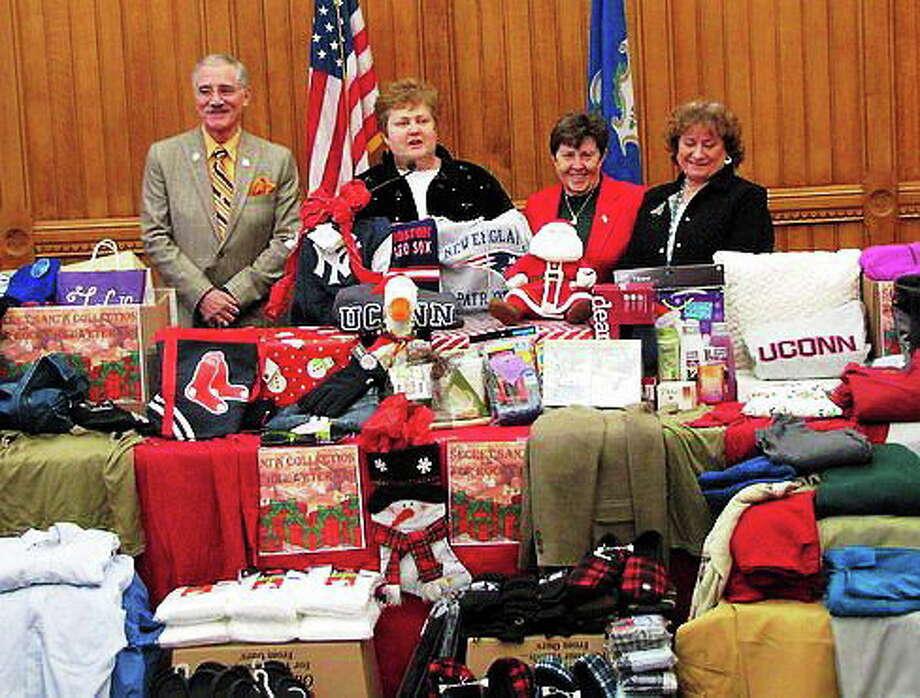 Reps. Frank Nicastro, Betty Boukus, and Claire Janowski with Veterans Commissioner Linda Schwartz Photo: Photo Courtesy Of CTNewsJunkie