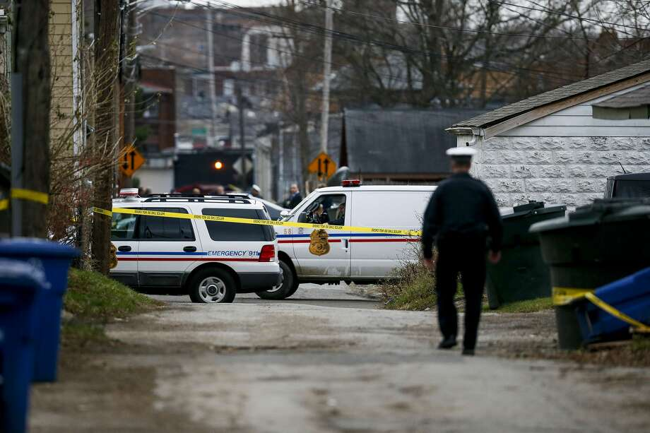 Columbus Police block an alley near 6th Avenue and Cortland Avenue in Columbus, Ohio while investigating the scene where the body of missing Ohio State football player, Kosta Karageorge was discovered in a dumpster on Nov. 30, 2014. According to police, Karageorge died of a self-inflicted gunshot wound. Photo: (AP Photo/The Columbus Dispatch, Kristen Zeis) / The Columbus Dispatch