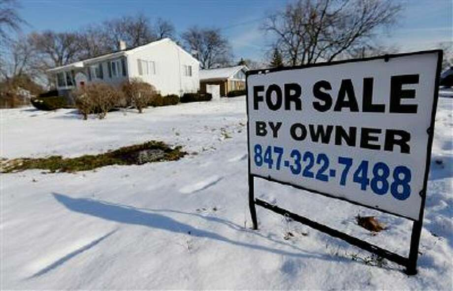 In this Friday, Dec. 27, 2013, file photo, a home is for sale in Glenview, Ill.   Freddie Mac reports on changes in average fixed mortgage rates for the first week of March 2014 on Thursday, March 13, 2014. (AP Photo/Nam Y. Huh, File) Photo: AP / AP