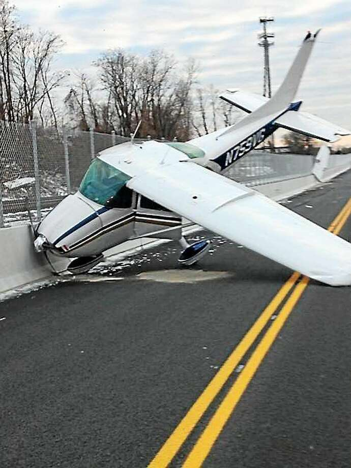 A single-engine plane made an emergency landing on the CTFastrak busway on New Park Avenue in West Hartford November 29, 2014. Photo: Contributed Photo — Hartford Police Deputy Chief Brian J. Foley