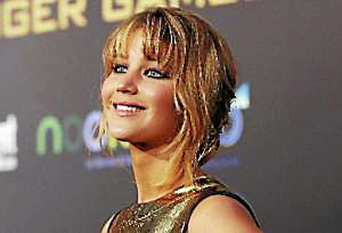 """Jennifer Lawrence poses at the premiere of """"The Hunger Games"""" at Nokia Theatre in Los Angeles, California in this March 12, 2012 file photo."""