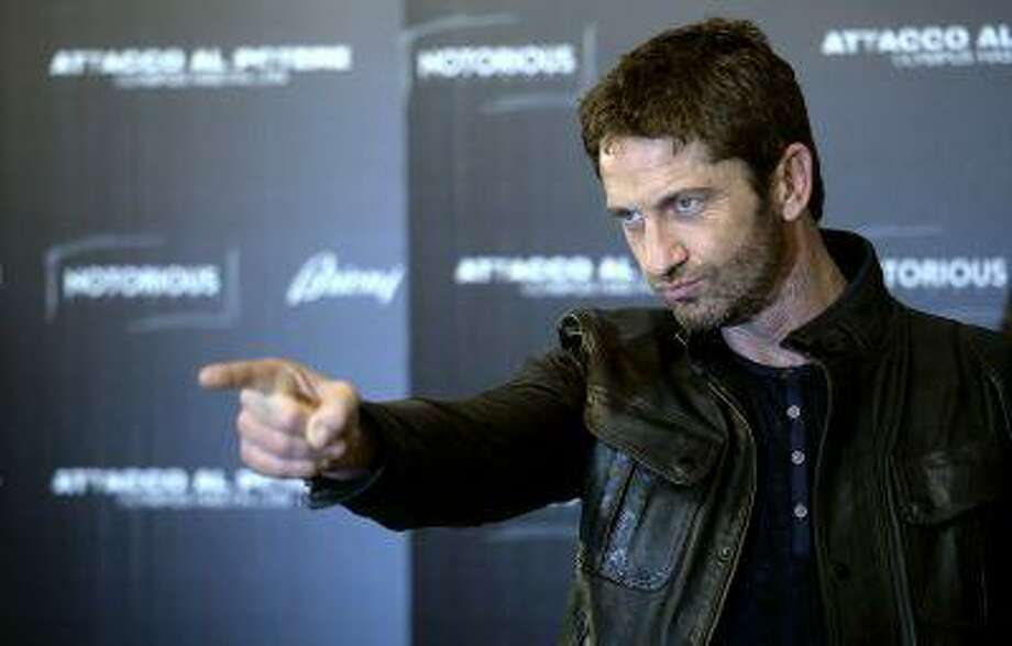 """Scottish actor Gerard Butler poses during a photocall for the movie """"Olympus has fallen"""" in downtown Rome on April 5, 2013. AFP PHOTO / Filippo MONTEFORTE (Photo credit should read FILIPPO MONTEFORTE/AFP/Getty Images) Photo: AFP/Getty Images / 2013 AFP"""