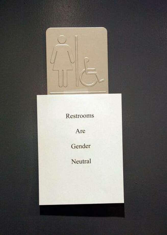 "A sign is posted at the entrance of the restrooms during the ""Transgender Day of Remembrance"" at the Metropolitan Community Church in West Hollywood, CA, 20 November 2006. Photo: AFP/Getty Images / 2006 AFP"