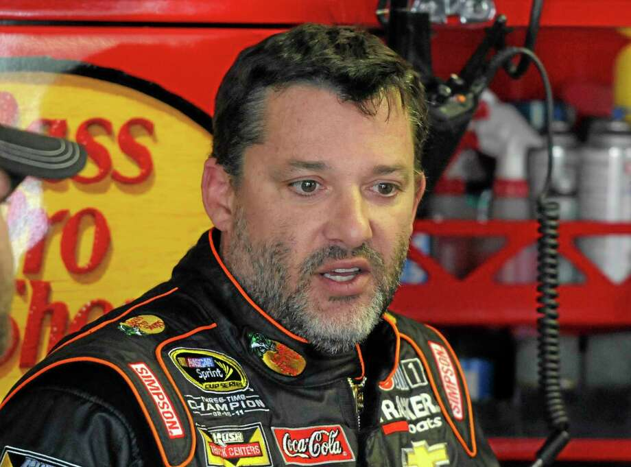 Tony Stewart will not race this weekend in Michigan. Photo: Mike McCarn — The Associated Press  / FR34342 AP