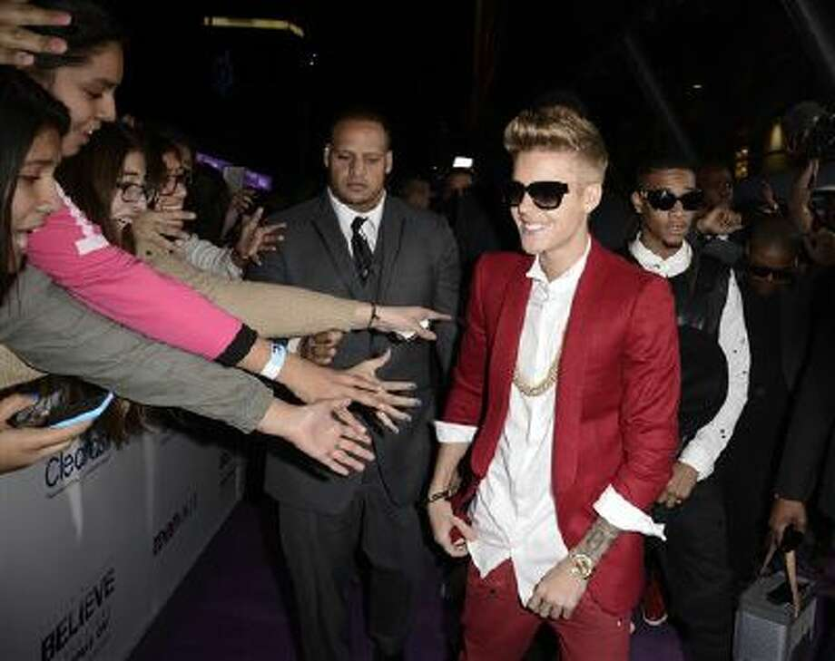 """Singer Justin Bieber arrives at the premiere of the feature film """"Justin Bieber's Believe"""" at Regal Cinemas L.A. Live on Wednesday, Dec. 18, 2013, in Los Angeles. Photo: Dan Steinberg/Invision/AP / Invision"""