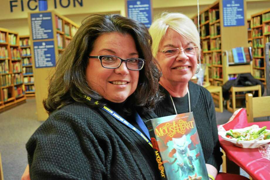 """Lisa Fiedler (left) was invited to show her new book, """"Mouseheart,"""" to students by Gilbert teacher Cheryl Caneschi. Photo: Ryan Flynn — Register Citizen"""