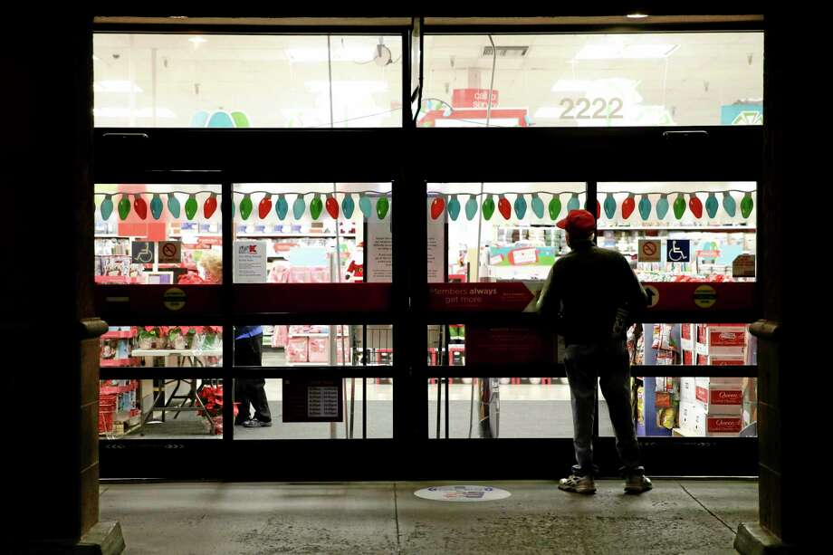A  shopper waits outside a Kmart store for it to open in Anaheim, Calif. Photo: Jae C. Hong — The Associated Press File Photo  / AP