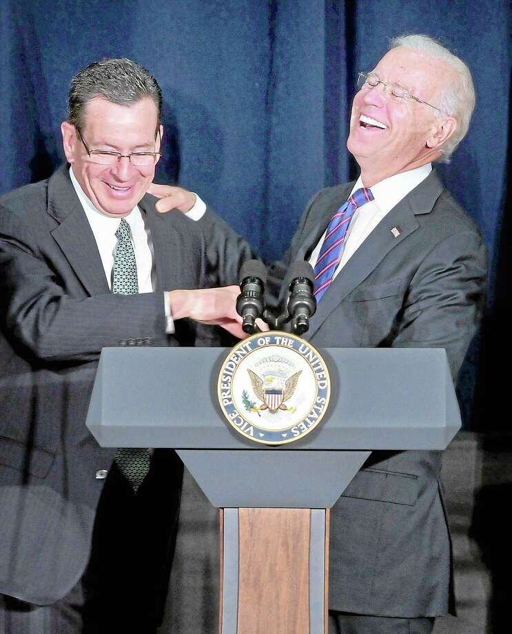 Gov. Dannel Malloy (left) jokes with Vice President Joe Biden (right) as he begins to speak at a Conference on Gun Violence at the Campus Center Ballroom at Western Connecticut State University in Danbury on 2/21/2013.  Malloy told the audience that Biden would mention his grandfather during his speech and when he did the audience laughed at the prediction coming true. ¬ Photo by Arnold Gold/New Haven Register Photo: Journal Register Co.