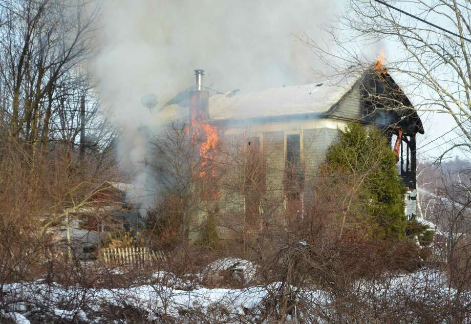 Fire rips through at house at Sugar Shack Farm, near the intersection of Ashley Road and Blue Street in Winchester Thursday afternoon. No injuries were reported at the scene. Photo: Kate Hartman—Register Citizen