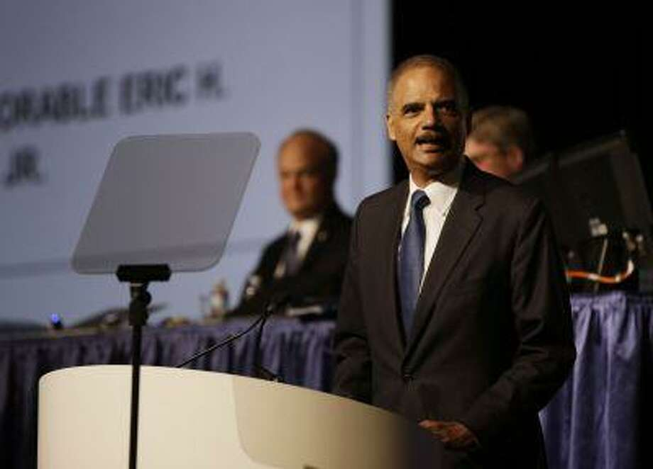 Attorney General Eric Holder speaks to the American Bar Association Annual Meeting Monday, Aug. 12, 2013, in San Francisco. In remarks to the association, Holder said the Obama administration is calling for major changes to the nation's criminal justice system that would cut back the use of harsh sentences for certain drug-related crimes. (AP Photo/Eric Risberg) Photo: AP / AP