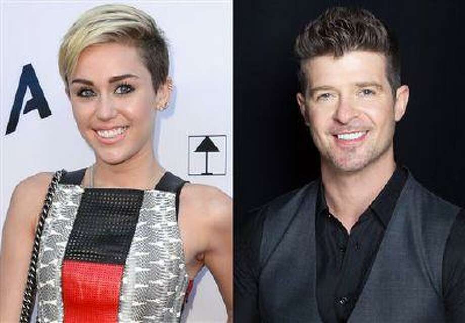This combination of file photos shows Miley Cyrus, left, in Los Angeles and Robin Thicke in New York. Cyrus and Thicke will perform their summer anthems at the MTV Video Music Awards later this month. (AP Photo) Photo: AP / Invision