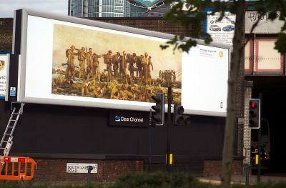 A copy of John Singer Sargent's painting 'Gassed', created in 1919, goes on display on an advertizment space in Vauxhall London on August 7 in London. John Singer Sargent's Gassed is part of Art Everywhere which is to showcase the nation's favourite British art works on tens of thousands of poster sites across the UK. Photo: Getty Images / 2013 Getty Images
