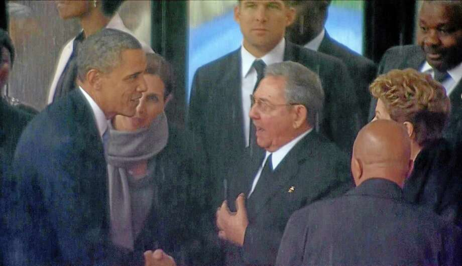 In this image from Presidents Barack Obama and Raúl Castro of Cuba shake hands at Nelson Mandela's memorial in Soweto, South Africa. Photo: AP Photo/SABC Pool / pool sabc