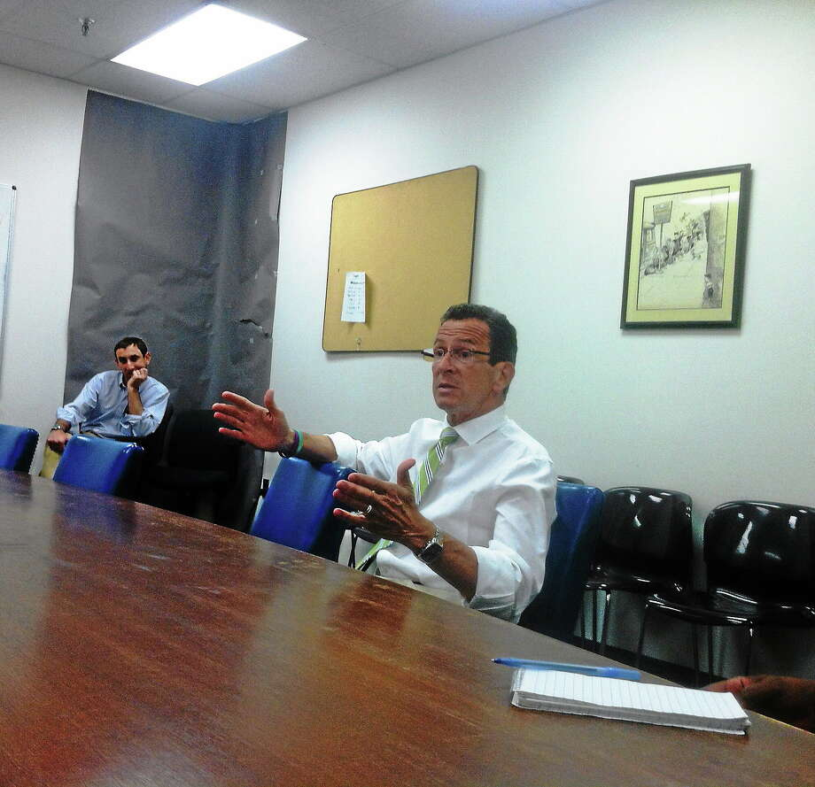 Connecticut Gov. Dannel P. Malloy makes a point during a campaign meeting with the New Haven Register editorial board. Photo: Journal Register Co.