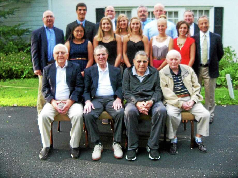 Torrington Varsity Alumni Club officers and scholarship recipients at the club's 40th scholarship banquet were front row, left to right: Lou Zanderigo; Andy Pace Dominic Toce; Frank Russo. Second row: Joann Duman; Caroline Teti; Makenzie Welch; Kiley Rosengrant; Paulina Kolada; Micaela Bottari; Mario Longobucco. Third row: Paul O'Heron; Nick LaMothe; Paul Denza; Fred Bonvicini; Ernie Tracy; Mark Reichenberg. Photo: Peter Wallace — Register Citizen