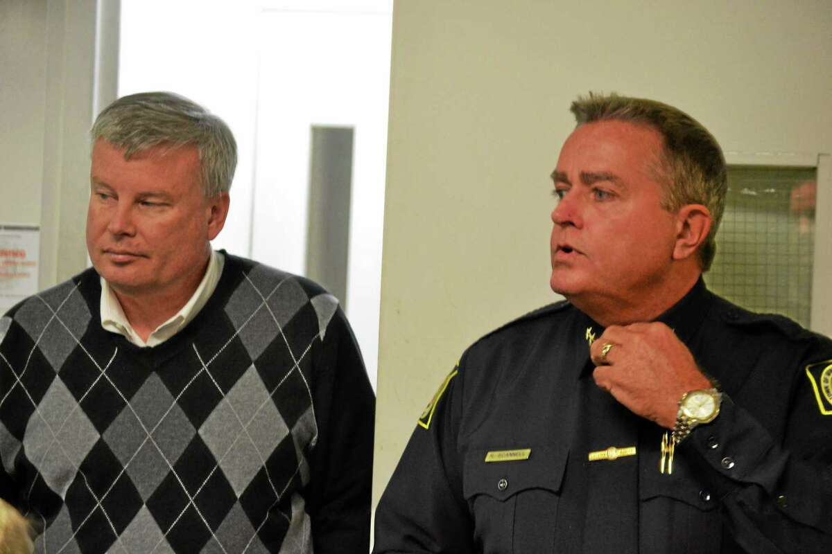 Winchester Police Chief Robert Scannell (right) gives Town Manager Dale Martin (left), members of the Board of Selectmen and others a tour of the police department in February. Scannell was hired as town manager in Watertown in August.