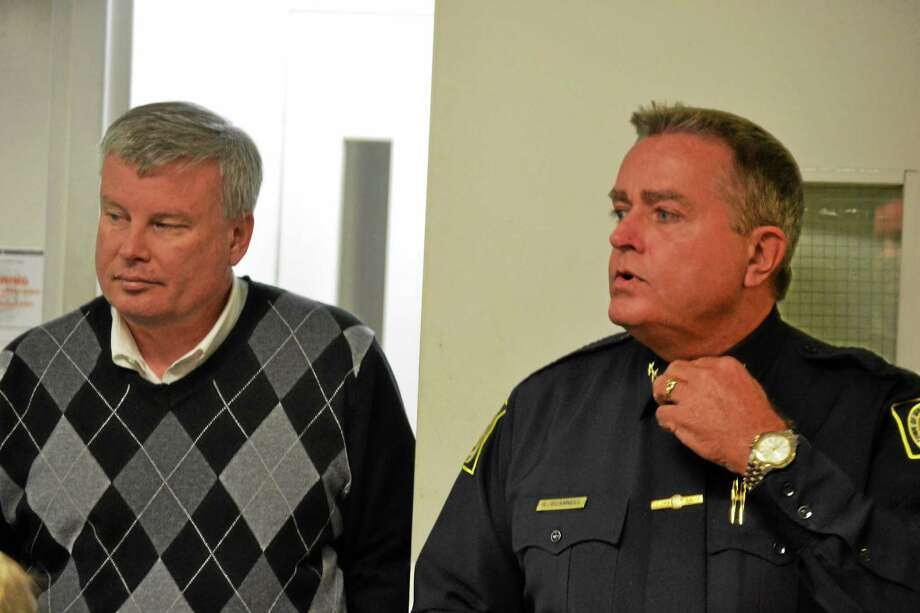 Winchester Police Chief Robert Scannell (right) gives Town Manager Dale Martin (left), members of the Board of Selectmen and others a tour of the police department in February. Scannell was hired as town manager in Watertown in August. Photo: Ryan Flynn — Register Citizen