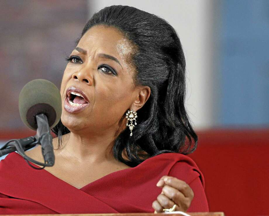 "FILE - In this May 30, 2013 file photo, Oprah Winfrey speaks during Harvard University's commencement ceremonies in Cambridge, Mass. Winfrey says she had a racist encounter while shopping in Switzerland _ and the apologetic national tourist office agrees. The billionaire media mogul told the U.S. program ""Entertainment Tonight"" that a shop assistant in Zurich refused to show her black handbag because it was ""too expensive"" for her. She was in town to attend last month's wedding of her longtime pal Tina Turner, who lives in a Swiss chateau along Lake Zurich. Forbes magazine estimates that Winfrey earned $77 million in the year ending in June. (AP Photo/Elise Amendola, File) Photo: AP / AP"